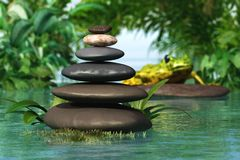 A pyramid of stones. Above the water. Massage parlor. Spa business royalty free stock photo