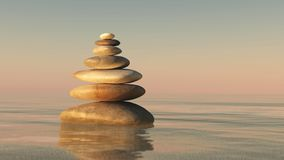 A pyramid of stones. Above the water. Massage parlor. Spa business royalty free stock images