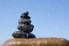 Pyramid stones & rain Stock Image