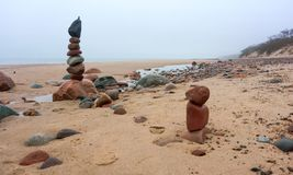 Pyramid of stones, rocky beach. Deserted beach in autumn stock photography