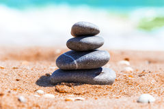 Pyramid of stones on sand. Macro view of pyramid of stones on sand royalty free stock photo