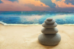 Pyramid of the stones on the sandy beach Royalty Free Stock Photography
