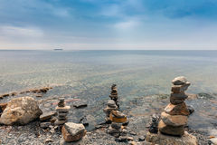 Pyramid of stones. In the sea Royalty Free Stock Image