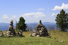 Pyramid of stones stacked on mountain top Tiyahta Royalty Free Stock Photos