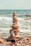 Pyramid from stones to the sea. A pyramid with stones stands on the sea Stock Photography
