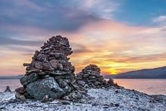 Pyramid of stones at sunset Royalty Free Stock Photo