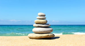 Pyramid of stones, zen. Balancing stones placed on the beach stock image