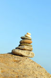 Pyramid of stones, zen concept. Placed stones balanced on a rock on the beach stock image