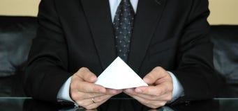 Pyramid of success. Businessman holding blank pyramid, concept of business success Stock Photo