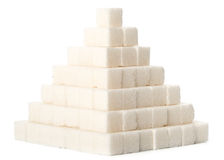 Pyramid from sugar cubes Royalty Free Stock Images