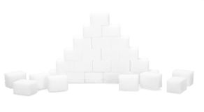 Pyramid of sugar cubes. R Isolated on white background Royalty Free Stock Photography