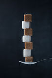 Pyramid of sugar cubes in a teaspoon Royalty Free Stock Photos