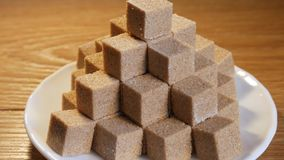 Pyramid from sugar cubes stock video