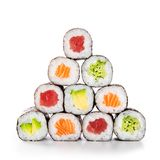Pyramid of sushi hosomaki. Fresh hosomaki in a pyramid isolated on white background. Sushi roll with salmon, tuna, avocado and cucumber. Traditional japanese stock photography