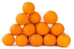 Pyramid of tangerines. Pyramid made of several tangerines on white background Stock Photos