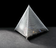 Pyramid tea bag Stock Images