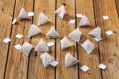 Pyramid tea bags. Jasmine tea bags on wood Stock Images