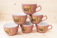 Pyramid of tea mugs Stock Image