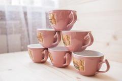 Pyramid of tea mugs side view Stock Photo