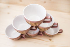 Pyramid of tea mugs view from above Stock Photos