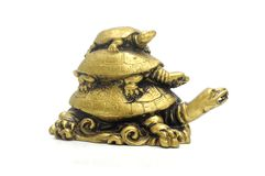 Pyramid of three bronze turtles Royalty Free Stock Photography