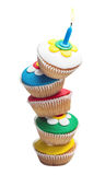 Pyramid of three colorful cupcakes Stock Images