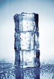 Pyramid of three ice cubes Stock Image