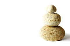 Pyramid of three stones. Over white royalty free stock image