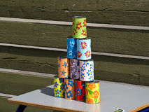 Pyramid of tin cans for throwing balls at them Royalty Free Stock Photo