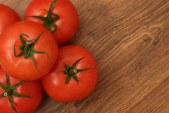 Pyramid of tomatoes. On the wooden table, view from above stock images