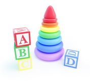 Pyramid toy and alphabet blocks. On a white background stock illustration