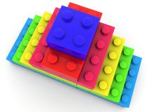 Pyramid of toy bricks top view. In backgrounds Royalty Free Stock Photography