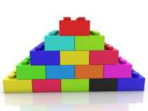 Pyramid of toy bricks in various colors Royalty Free Stock Images