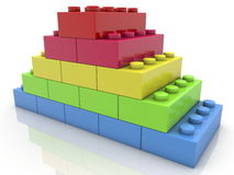 Pyramid of toy bricks on white Royalty Free Stock Photos
