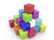 Pyramid of toy cubes in different colors Stock Photography