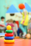 Pyramid toy stand at table in kindergarten Stock Image