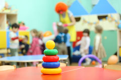 Pyramid toy stand at table in kindergarten Stock Images