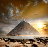 Pyramid under clouds Royalty Free Stock Image