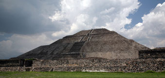 Pyramid w Approaching Storm. Pyramid of the Sun, part of the ancient city of Teotihuacan, City of the Gods, in Mexico - near Mexico City. A sacred site visited Stock Photo