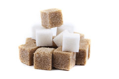 Pyramid of lump sugar on a white background Royalty Free Stock Images
