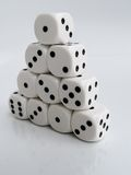Pyramid of white dice Stock Images