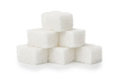 Pyramid of white sugar lump isolated on white Stock Photography