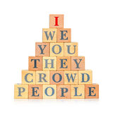 Pyramid of wooden blocks with words. Concept of individuality and egoism Stock Photography