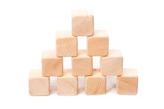 Pyramid from wooden cubes Royalty Free Stock Photo