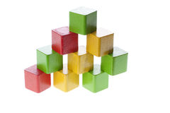 Pyramid with wooden cubes Royalty Free Stock Image