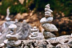 Pyramid of zen stones on the rocky mountains stream shore Stock Image