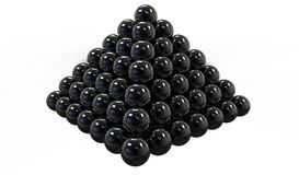 Pyramida_black. Balls stacked in a pyramid, white background Stock Image