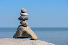 Pyramidal group of stones. Balancing some of stones on the seashore royalty free stock images