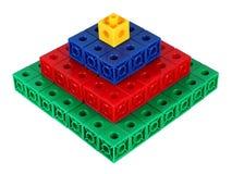 Pyramide colorée de bloc Photos libres de droits