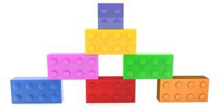 Pyramide des briques de jouet empilées par côté dans diverses couleurs illustration stock